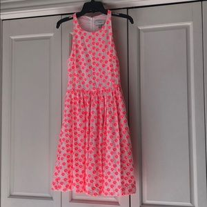 Pink and white embroidered floral sundress.